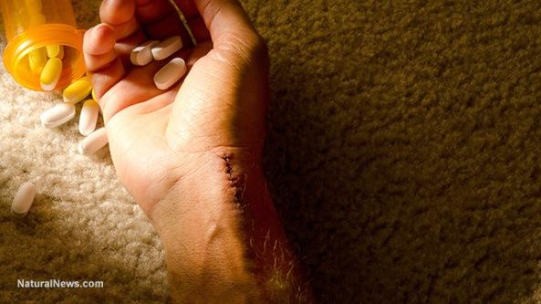 hand-close-up-pills-overdose-addiction