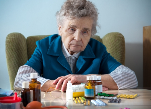 senior-elderly-woman-drugs-prescription-pills-sad