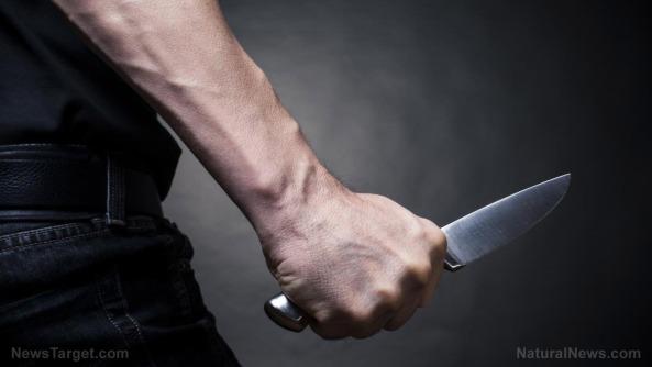 the-man-knife-hand-closeup