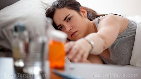 woman-reach-drugs-prescription-pills-sick-bed