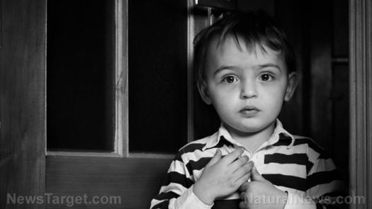 toddler-boy-stripped-shirt-sad