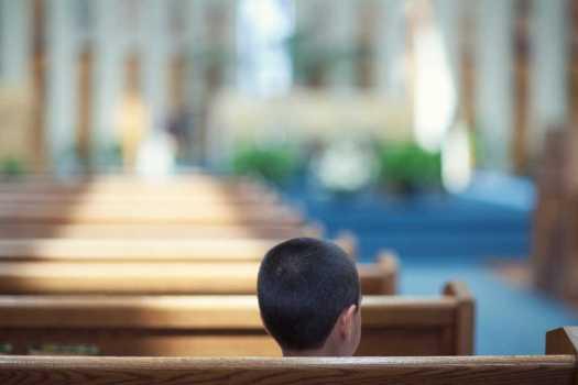 child sitting alone in church