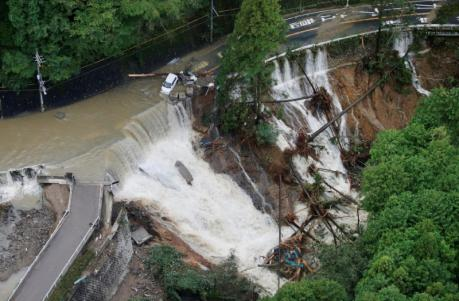 A collapsed road is seen following torrential rain caused by typhoon Lan in Kishiwada