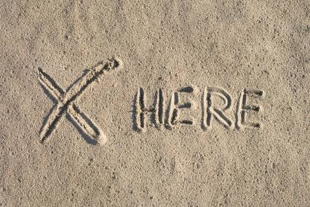 25452523-mysterious-sign-on-sand