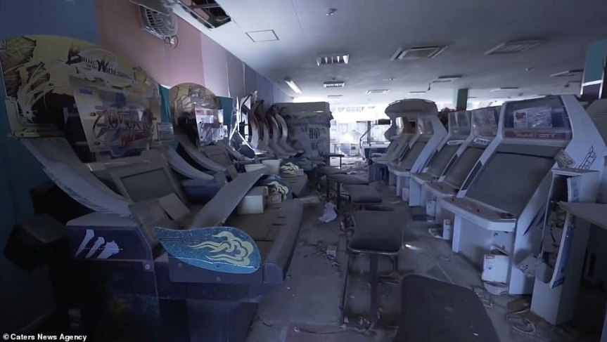 Inside Fukushima's red zone: Eerie photos show abandoned SEGA arcade 'covered in radioactive dust' in off-limits area near nuclear powerplant