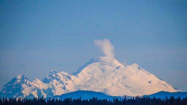 Sleeping volcano Mount Baker venting dream clouds of steam and gas this month